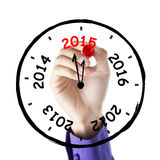 Hand drawing annual clock. Hand makes annual clock with number 2012, 2013, 2014, 2015, on whiteboard Royalty Free Stock Photo