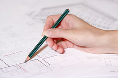 Hand drawing architectural plan with pencil royalty free stock images