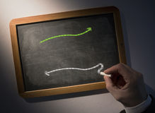 Hand drawing arrows on chalkboard Stock Photo