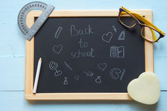 Hand drawing back to school on a chalkboard Royalty Free Stock Image