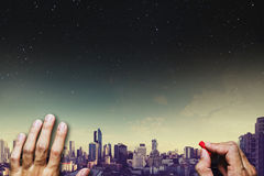 Hand drawing on blackboard, with panoramic city view with sky and stars at night background Royalty Free Stock Photo