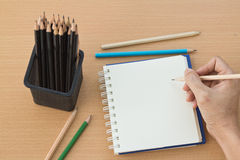 Hand drawing with blank paper on wooden. Hand drawing with blank paper and colorful pencils on wooden table Stock Images