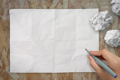 Hand drawing on blank wrinkled paper Stock Images