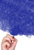 Hand drawing with a blue pencil Stock Photo