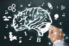 Hand drawing brain sketch on blackboard. Create a graphic like t stock photos