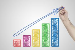 Hand drawing business chart graph on white board symbolizing growth.  Royalty Free Stock Images