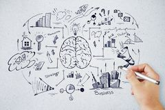 Brainstorm and leadership concept. Hand drawing business sketch on concrete wall background. Brainstorm and leadership concept Stock Photos