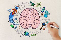 Brainstorm and success concept. Hand drawing business sketch on concrete wall background. Brainstorm and success concept Royalty Free Stock Photography