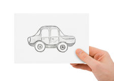 Hand with drawing car. Isolated on white background Royalty Free Stock Photo