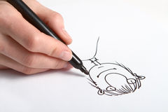 Hand drawing caricature. Human Hand drawing caricature of man stock photo