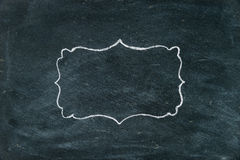 Hand drawing chalk frame on blackboard Stock Image