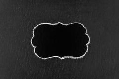 Hand drawing chalk frame on blackboard Royalty Free Stock Photos