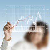 Hand drawing a chart. Businesswoman hand drawing a chart Stock Photo