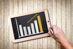 Hand drawing a chart on a chalkboard royalty free stock image