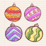 Hand Drawing of Christmas Ball Decoration on Paper Stock Photos
