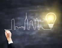 Hand drawing city and bulb Stock Photography