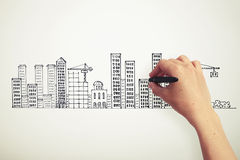 Hand drawing city on the paper Royalty Free Stock Photos