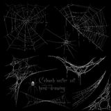 Hand drawing cobweb set. In vector on black background Stock Photos