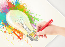 Hand drawing colorful idea light bulb with a pen Stock Image