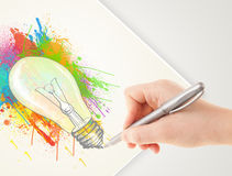 Hand drawing colorful idea light bulb with a pen Stock Images