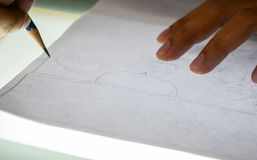 Hand drawing comic. On a light table intently Royalty Free Stock Photos