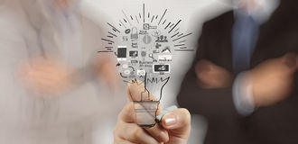 Hand drawing creative business strategy. With light bulb as concept Royalty Free Stock Photo