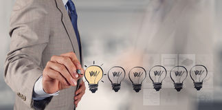 Hand drawing creative business strategy. With light bulb as concept stock photography