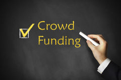 Hand drawing crowd funding on a chalk board Royalty Free Stock Photo
