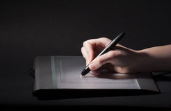 Hand drawing on design tablet, low key style Stock Photography