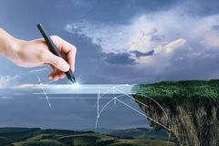 Hand drawing digital bridge. Hand drawing abstract digital bridge on landscape background. Imagination concept stock image