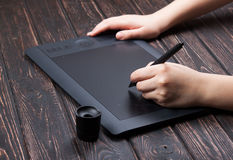 Hand is drawing on a digital graphic tablet Royalty Free Stock Photography