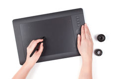 Hand is drawing on a digital graphic tablet Royalty Free Stock Photos