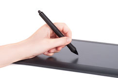 Hand is drawing on a digital graphic tablet. With pen Stock Photography
