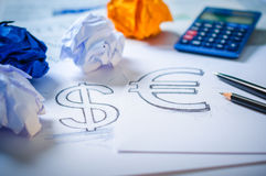 Hand drawing a dollar sign and euro sign Royalty Free Stock Photo