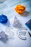 Hand drawing a dollar sign and euro sign Stock Photo