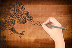 Hand drawing dragon statue. Royalty Free Stock Image