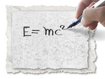 Hand drawing E=mc2 on paper Stock Photos