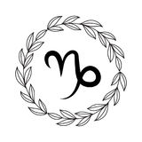 Hand drawing flat capricorn symbol. In rustic floral wreath Stock Photo