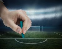 Hand drawing on football pitch Stock Photography