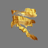 Hand drawing gold brush stroke paint spot on a gray background Stock Photo