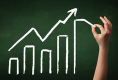 Hand drawing graph on blackboard Royalty Free Stock Photography