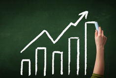Hand drawing graph on blackboard Royalty Free Stock Photo