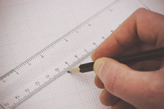 Hand drawing in graph paper Royalty Free Stock Photo