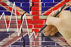 Hand drawing a graph about the performance of the English econom Royalty Free Stock Photo