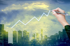 Hand drawing graph with sky and city background Royalty Free Stock Photos