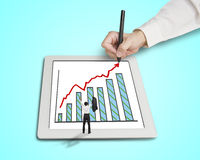 Hand drawing growth arrow, chart on tablet  with cheered busines Stock Image