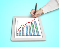 Hand drawing growth red arrow and chart on table. In green background Stock Photos