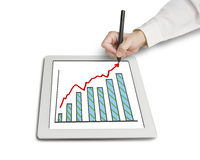 Hand drawing growth red arrow and chart on table. In white background Royalty Free Stock Photo