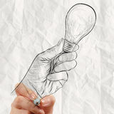 Hand drawing hand hold light bulb Stock Photography