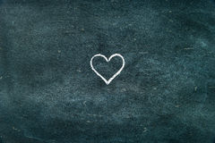 Hand drawing heart shape symbol on blackboard. As design resource, copy paste available Royalty Free Stock Photo